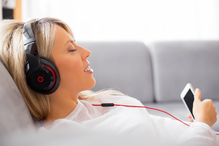Relaxed_Woman_Listening_to_Headphones_Bigstock_80631245