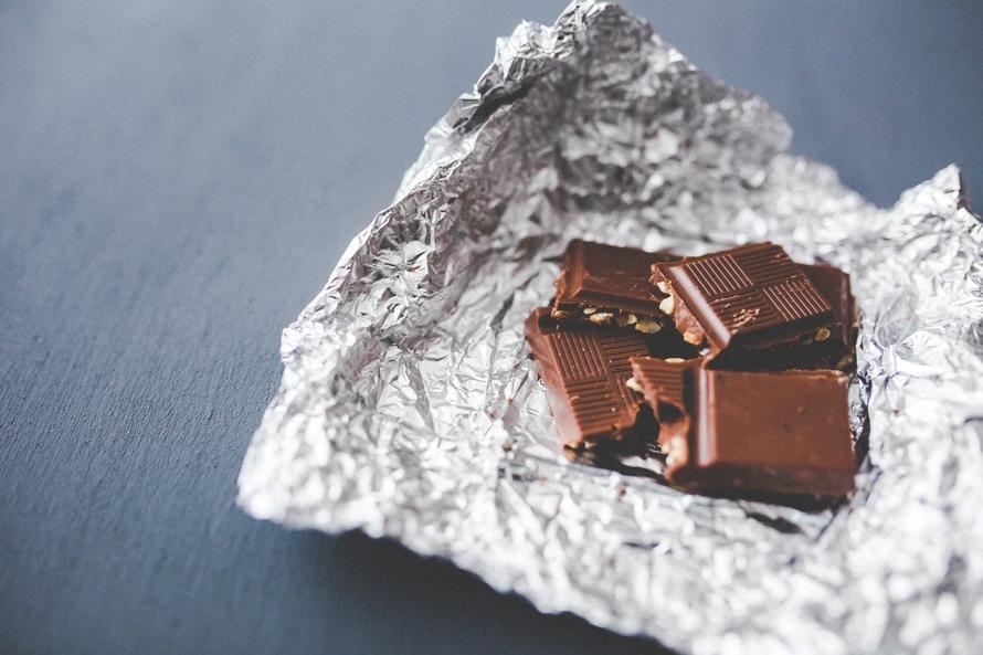 Unwrapped dark chocolate bar