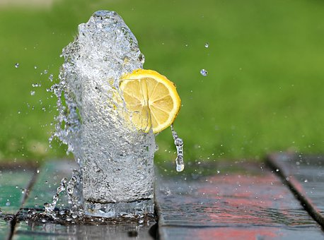 Refreshing glass of water with lemon